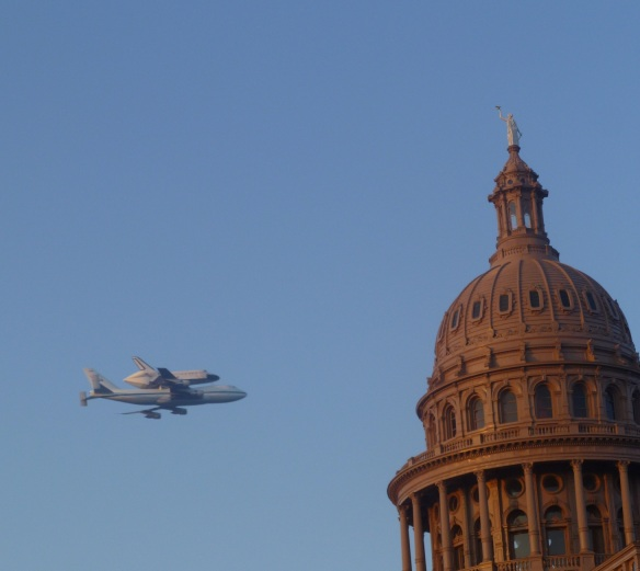 Space shuttle Endeavour flying past the Texas Capitol dome