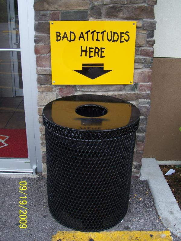 A sign saying leave bad attitudes in the trash can