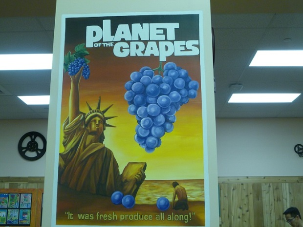 A sign with a pun: Planet of the Grapes; It was fresh produce all along.