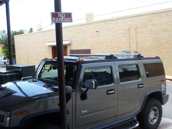 A vehicle parked under a No Parking sign