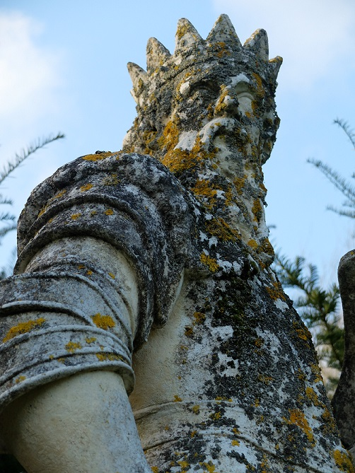 Friday Fictioneer photo prompt: An ancient statue of a crowned man.  Copyright Claire Fuller