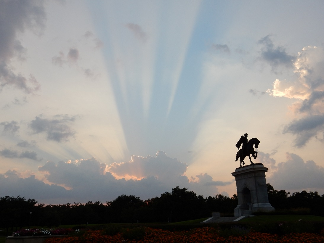 Sunset in Houston, Texas, with the statue of Sam Houston at the right side of the photo