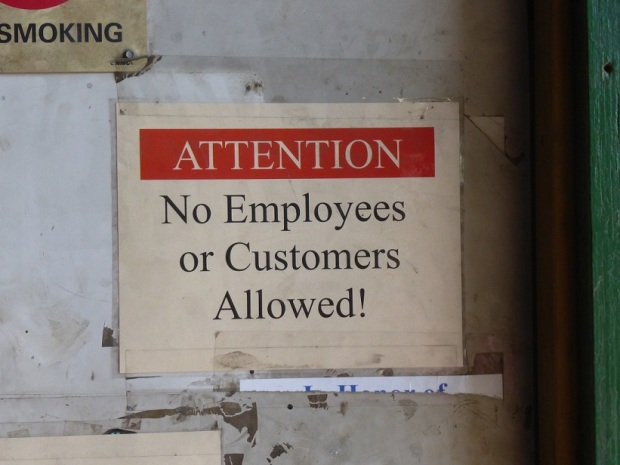 A sign at a recycling business that reads: Attention.  No employees or customers allowed.