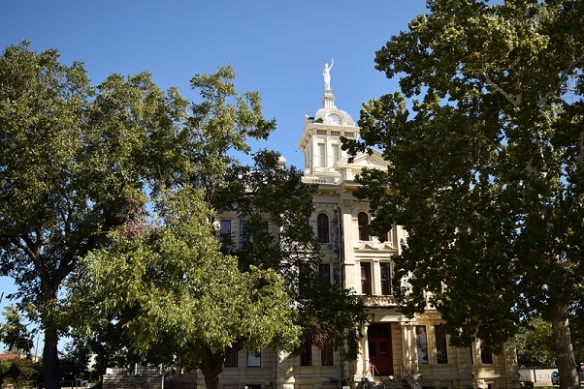South view of the Milam County Courthouse, with lots of trees