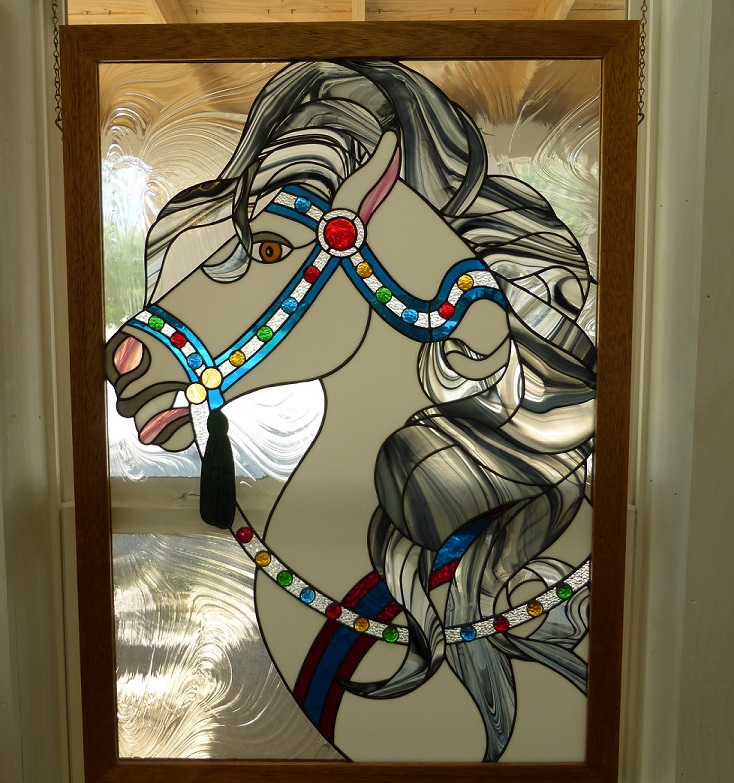 A stained glass window of a carousel horse
