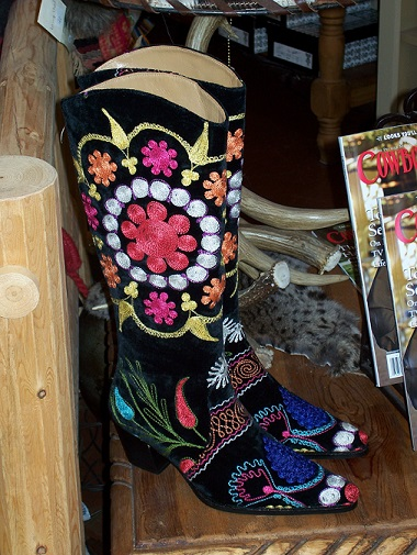 A pair of cowboy boots with lots of color