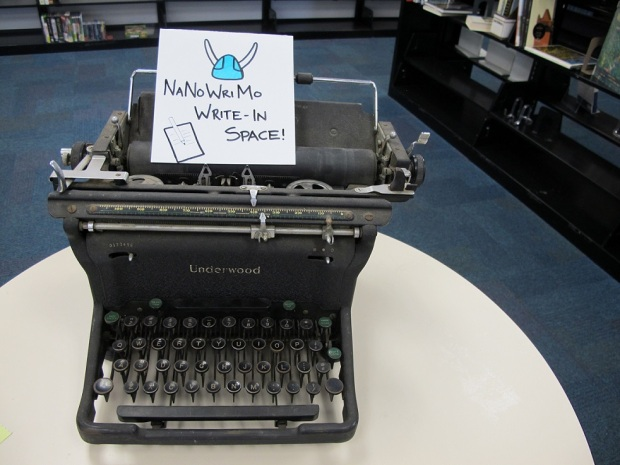 """The sign on the typewriter that says """"NaNoWriMo Write-In Space"""""""