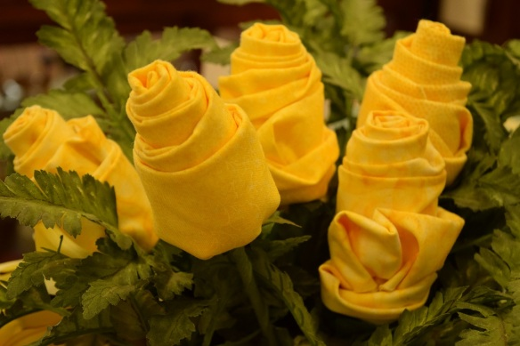 A bouquet of roses made from yellow quilting fabric