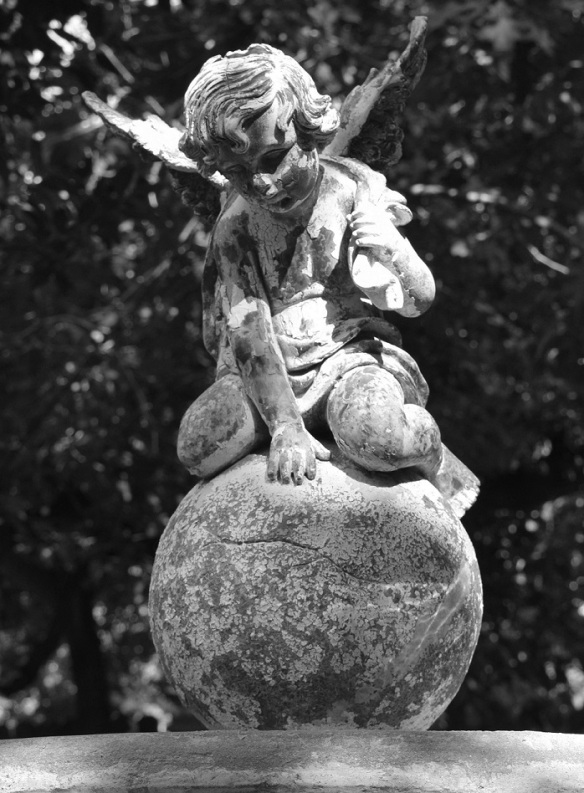 garden angel statue in a black and white photo