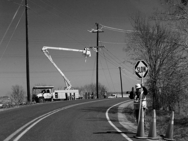 Workers at a curve on a road