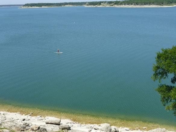 A paddleboarder on Lake Belton, Texas