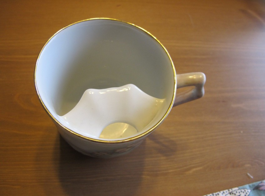 The mustache protector part of the tea cup