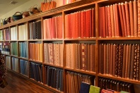 Wall of fabric at The Quilted Skein, La Grange, Texas