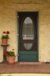 House door with geraniums