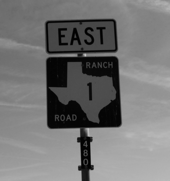 """Texas highway sign indicating """"East, Ranch Road 1"""""""