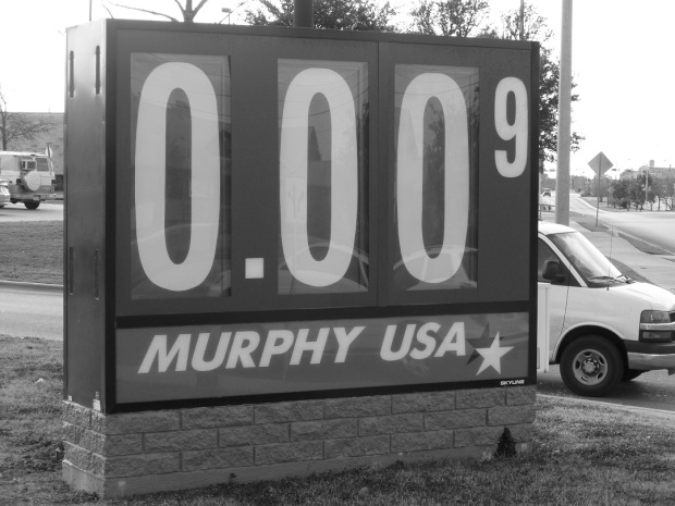 A gas price sign indicating 0.009 cents per gallon (not correct, of course)