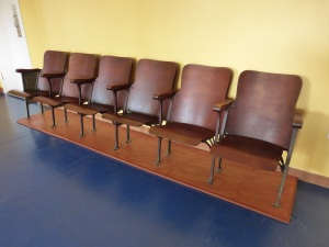 A row of chairs, probably from a Texas courthouse