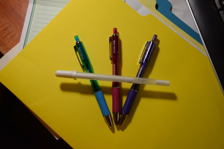 Four pens: one pink, one blue, one purple, one white
