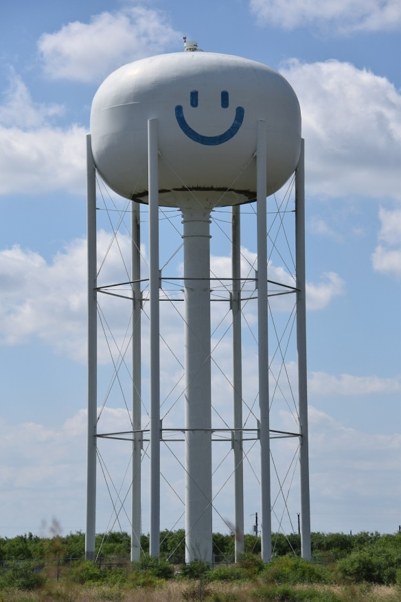 Water tower near Cedar Creek, Texas; water tower has a smiley face on it