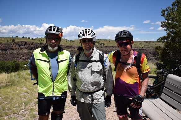 Three cyclists on the trail