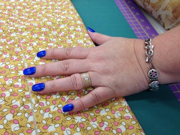 Fingernails with blue nail polish