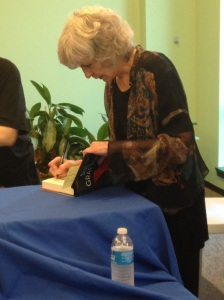 Sue Grafton signing books