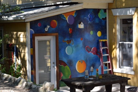 An exterior wall with art painted on it
