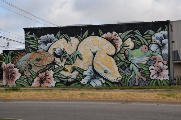 Mural with a toad, snake, and gecko