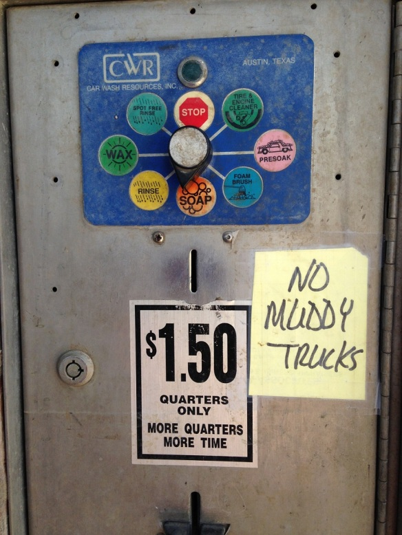 "Hand-written sign saying ""No Muddy Trucks"" at the self-service car wash"