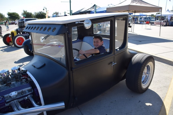 A young boy sitting in an old, old car at the Buda Gearhead's car show October 2015