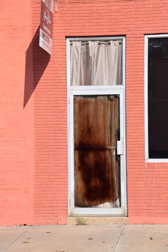 A stained door in La Grange, Texas