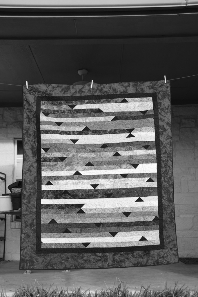 A blue and black jelly roll quilt. (Color photo scheduled to post 16 Nov 2015)