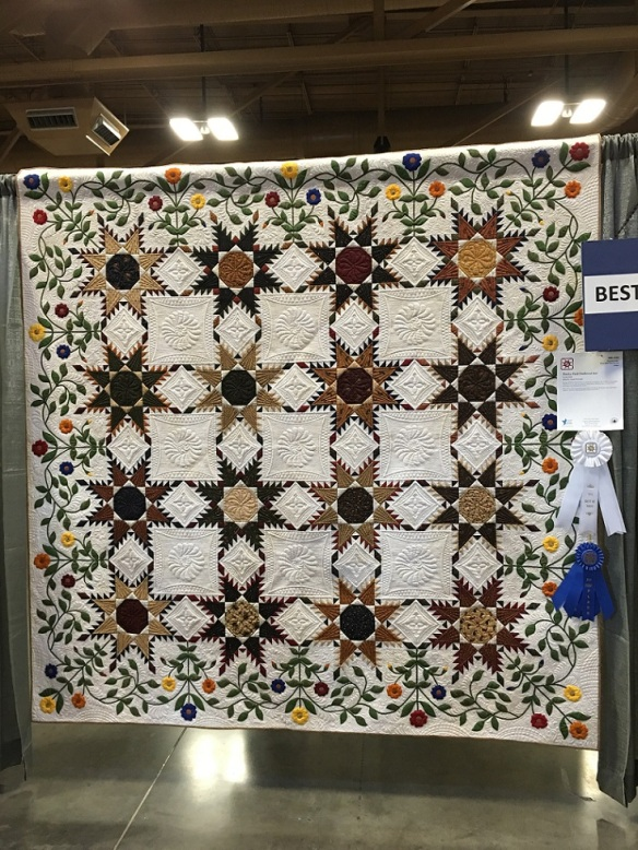 """Paisley Park Feathered Star"" won Best in Show quilt by Judy Wolff, quilted by Angela McCorkle"