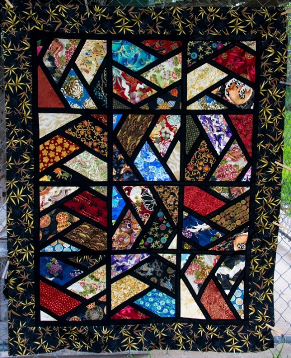 Half Hexagon quilt in Asian fabrics