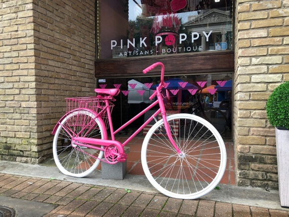 Pink bicycle in front of the Pink Poppy, Georgetown, Texas